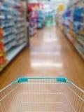 Supermarket shelves aisle blurred background Stock Photography