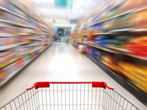 Supermarket shelves aisle blurred background Royalty Free Stock Photo