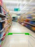 Supermarket shelves aisle blurred background Royalty Free Stock Photography