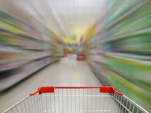 Supermarket shelves aisle blurred background Stock Image
