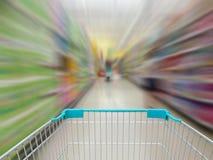 Supermarket shelves aisle blurred background Royalty Free Stock Photo
