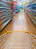 Supermarket shelves aisle blurred background Royalty Free Stock Images