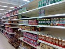 Beer shelves. Supermarket shelves with beers and birrels Stock Photos