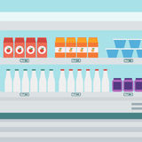 Supermarket shelves with dairy products. Stock Photo