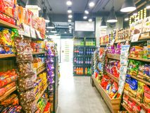 Supermarket shelves filled with FMCG grocery products stock photos