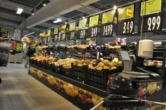Supermarket. Shelves with products in supermarket, hypermarket Stock Images