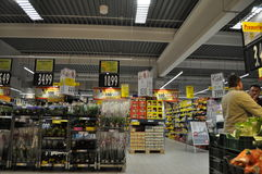Supermarket. Shelves with products in supermarket, hypermarket Stock Photography