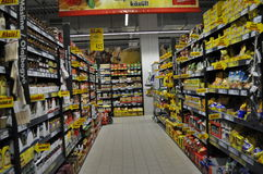 Supermarket. Shelves with products in supermarket, hypermarket Royalty Free Stock Photo
