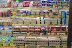 Supermarket shelves Stock Images