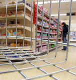 Supermarket shop basket trolley. Photo of woman doing her weekly supermarket shopping with view from inside basket or trolley Royalty Free Stock Photos