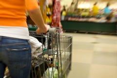 Supermarket Shopper blurred stock photo