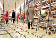 Supermarket shoppers cart view. Photo of shoppers in supermarket store view from inside basket or trolley Stock Photography
