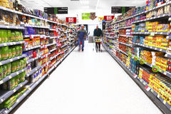 Supermarket shopping. Food products aisle Stock Images