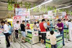 Supermarket  shopping. Food sales in a supermarket in China.As the inflation comes,the price in the market in China goes high. This picture shows the exit Royalty Free Stock Image