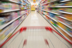 Supermarket with a shopping cart Stock Images