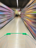 Supermarket shopping cart view with supermarket aisle motion Stock Photos