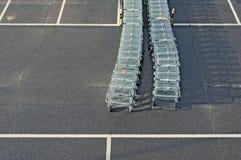 Supermarket shopping carts. Row of shopping carts waiting for customers Royalty Free Stock Photography