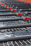 Supermarket shopping trolley. Rows of unbranded shopping trollies at the supermarket Royalty Free Stock Image