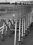 Supermarket shopping trollies carts. Photo of supermarket coin operated shopping trollies parked in a row Royalty Free Stock Image