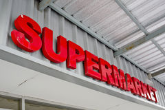Supermarket sign on building