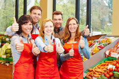 Supermarket staff team holding Stock Photos