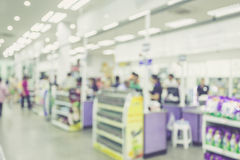 Supermarket store blur background ,Cashier counter with customer Stock Images