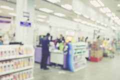 Supermarket store blur background ,Cashier counter with customer. Vintage filter effect royalty free stock photography