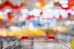Supermarket store blur background with shopping cart. Supermarket store abstract blur background with shopping cart stock photos