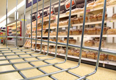 Supermarket store bread basket. Photo of bakery section in supermarket store view from inside customers trolley or basket Royalty Free Stock Photo