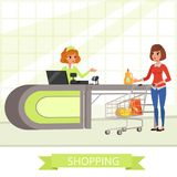 Supermarket store cashier and customer with grocery shopping cart. Young cartoon women characters. Flat shop counter Royalty Free Stock Images