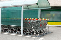 Supermarket Trolley. In the parking Royalty Free Stock Image