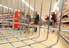 Supermarket trolley basket Stock Images