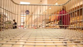 Supermarket trolley dash stock video