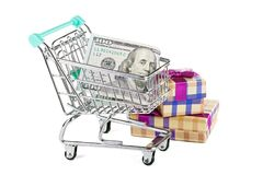 A supermarket trolley with dollars and purchases. Concept - sales and discounts Stock Image