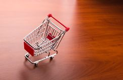 Supermarket trolley on the floor Stock Photos