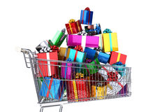 Supermarket trolley full of many multicolored gifts. Side view, on white background. Clipping path included Royalty Free Stock Photo