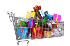 Supermarket trolley full of multicolored gifts. Side view, on white background. Clipping path included Royalty Free Stock Images