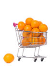 Supermarket trolley full of oranges Stock Photos