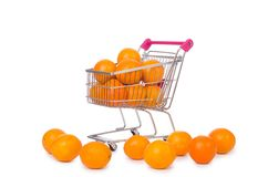 Supermarket trolley full of oranges Royalty Free Stock Image