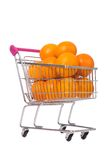 Supermarket trolley full of oranges Stock Photo