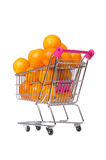 Supermarket trolley full of oranges isolated on Royalty Free Stock Images