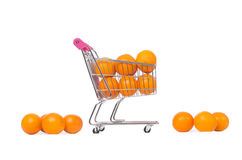 Supermarket trolley full of oranges isolated on Stock Image