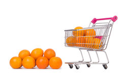 Supermarket trolley full of oranges Stock Photography