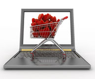 Supermarket trolley full of red hearts on laptop Stock Photos