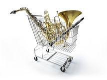 Supermarket trolley full of wind musical instruments. Royalty Free Stock Images