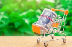 Supermarket trolley on a green background. The concept of shopping online. Place market, commerce, Internet commerce. Ordering goo. Ds and services through the stock images
