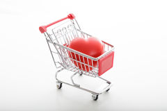 Supermarket trolley. Metal supermarket trolley on white Royalty Free Stock Photo