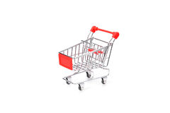 Supermarket trolley. Model of supermarket trolley on white background Stock Photos