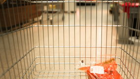 Supermarket trolley moving. View from carts stock footage