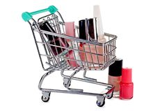 Supermarket trolley with nail polish. Concept - sales and discounts on cosmetics Stock Photography
